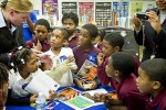 Teacher Meets with Elementary Students - photo by Nasa HQ Photo