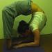 Woman doing backbend drop